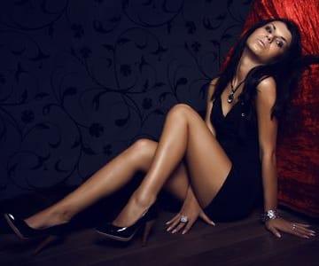 Hot girl sitting on the floor