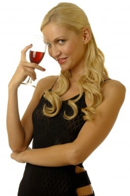 A cute woman holding a wine class